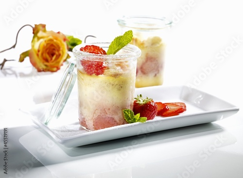 Cheese cake with strawberries in jars