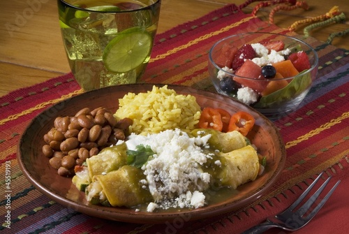 Rolled Veggie Stuffed Tortillas with Green Salsa (Enchiladas de Calabacita en Salsa Verde)