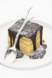Baumkuchen (German layer cake) with chocolate sauce and sugar