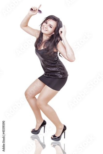 woman is dancing on a dancefloor