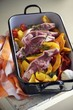 Raw lamp chops with a pumpkin medley in a roasting tin