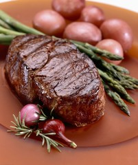 Whole Steak Served with Asparagus and Red Potatoes