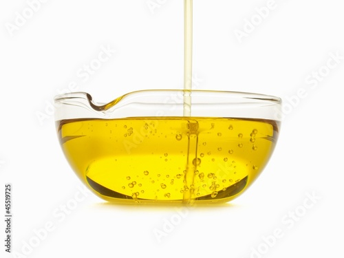 Oil Pouring into a Bowl
