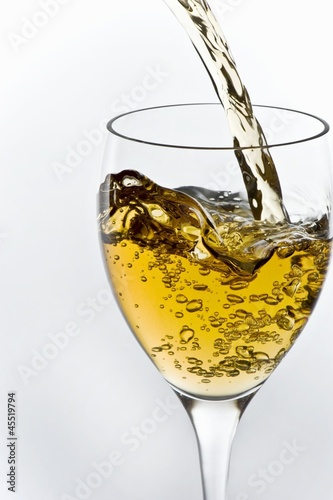 Sauvignon Blanc Wine Pouring into a Glass