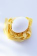A fresh egg on tagliatelle