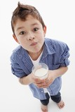 Little boy drinking milk