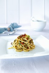 Spaghetti with dried tomatoes, herbs and olives