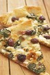 Two Slices of Greek Style Pizza with Kalamata Olives, Feta Cheese and Spinach