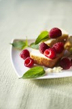Piece of Pound Cake with Fresh Raspberries and Pineapple Sage