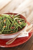 Serving Bowl of Green Beans with Marcona Almonds and Cranberries; Spoon