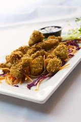 Fried Shrimp Appetizer on a Plate with Shredded Carrots and Cabbage