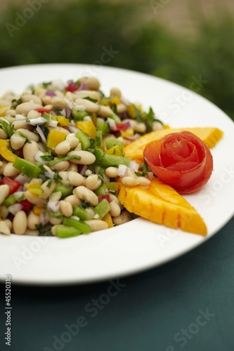 Bowl of White Bean Salad with Papaya Garnish