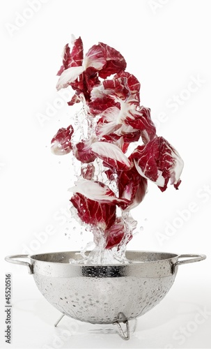 Radicchio being washed in a colander