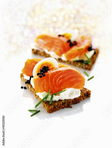 Whole-grain bread with cottage cheese, salmon, egg and caviar