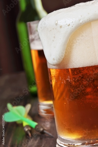 Foam Spilling Over the Top of a Glass of Beer