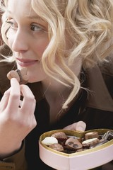 Young secretly eating chocolates