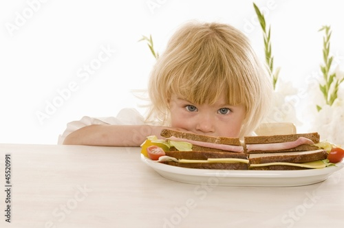 Little girl with sandwiches