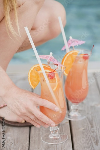 Woman with Planter's Punch by pool