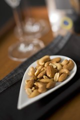 Various nuts in a white dish