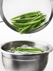 Blanched beans being quenched in iced water