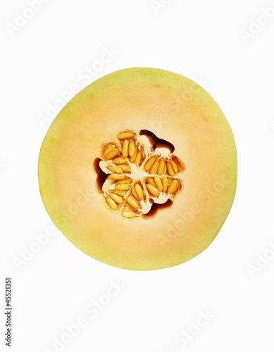 Half of a Cantaloupe Melon with Seeds; White Background