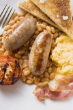 Baked beans with sausages, scrambled egg, bacon, tomato, toast
