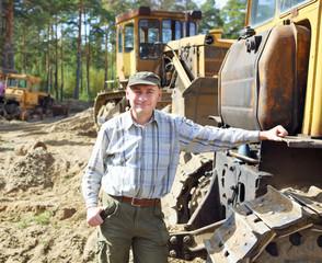 Portrait  a driver of construction equipment