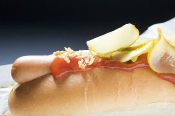 Hot dog with ketchup and gherkins (detail)