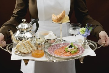 Chambermaid serving luxury breakfast tray