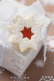 Jam-filled star biscuit on white box (Christmas)
