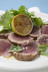 Seared, seasoned tuna fillet with coriander leaves