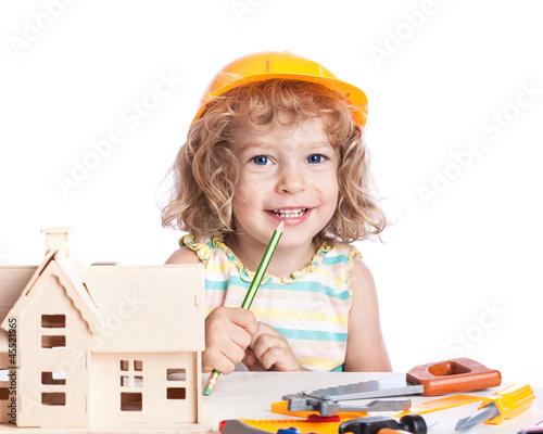 Child building house