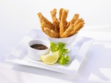 Breaded, deep-fried chicken strips with dip