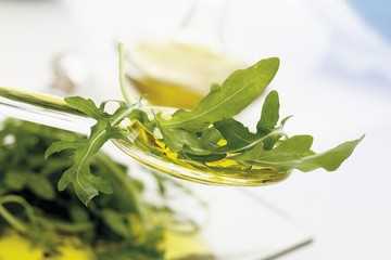 Rocket on a spoonful of olive oil
