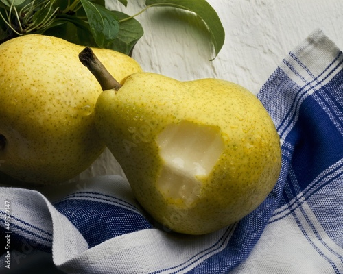 Two Pears on Dish Towel, One with Bite Taken Out