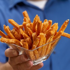 Man Holding a Glass Bowl of Sweet Potato Fries
