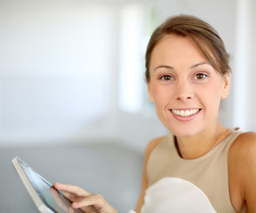 Portrait of beautiful woman using tablet
