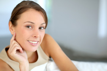 Beautiful smiling woman relaxing in sofa