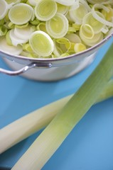 Leek rings in bowl, leeks in front