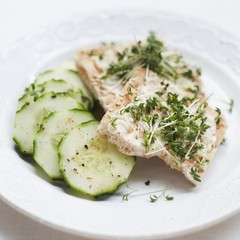 Crispbread with cress and cucumber slices