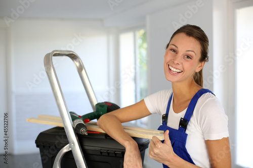 Cheerful young woman ready to reform house