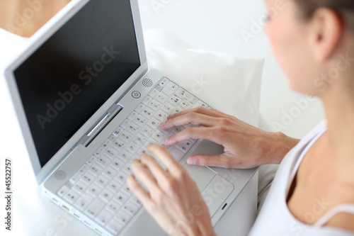 Closeup of woman using laptop computer