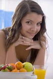 Girl with fresh fruit and orange juice