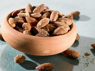 Salted almonds in terracotta bowl