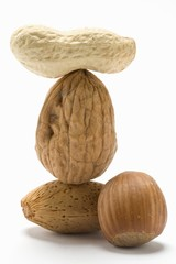 Assorted nuts, some stacked