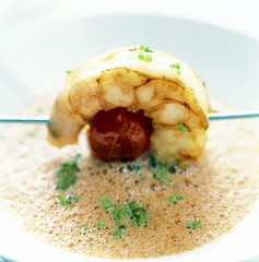 Frothy soup with a prawn and tomato kebab