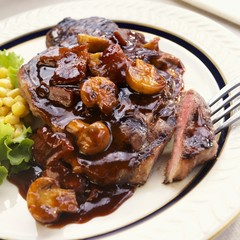 Steak with Bacon Mushroom Sauce; Piece on a Fork