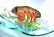 Tomato slices and mozzarella on rosemary skewer