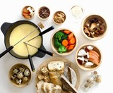Cheese fondue with vegetables, mushrooms, bread