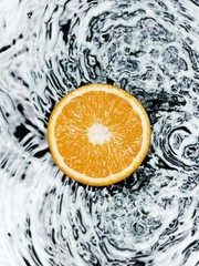 Half an orange on water